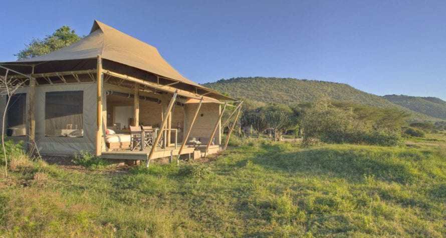 &Beyond Kichwa Tembo Tented Camp, a Masai Mara safari lodge, is superbly located on the edge of this iconic safari destination. © &Beyond