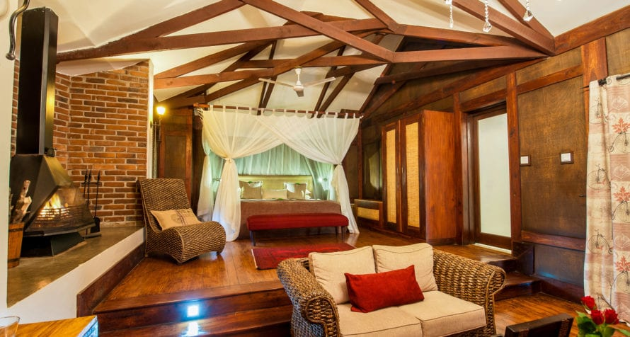 Your personal fireplace will warm your room at Elewana Arusha Coffee Lodge. © Elewana Collection