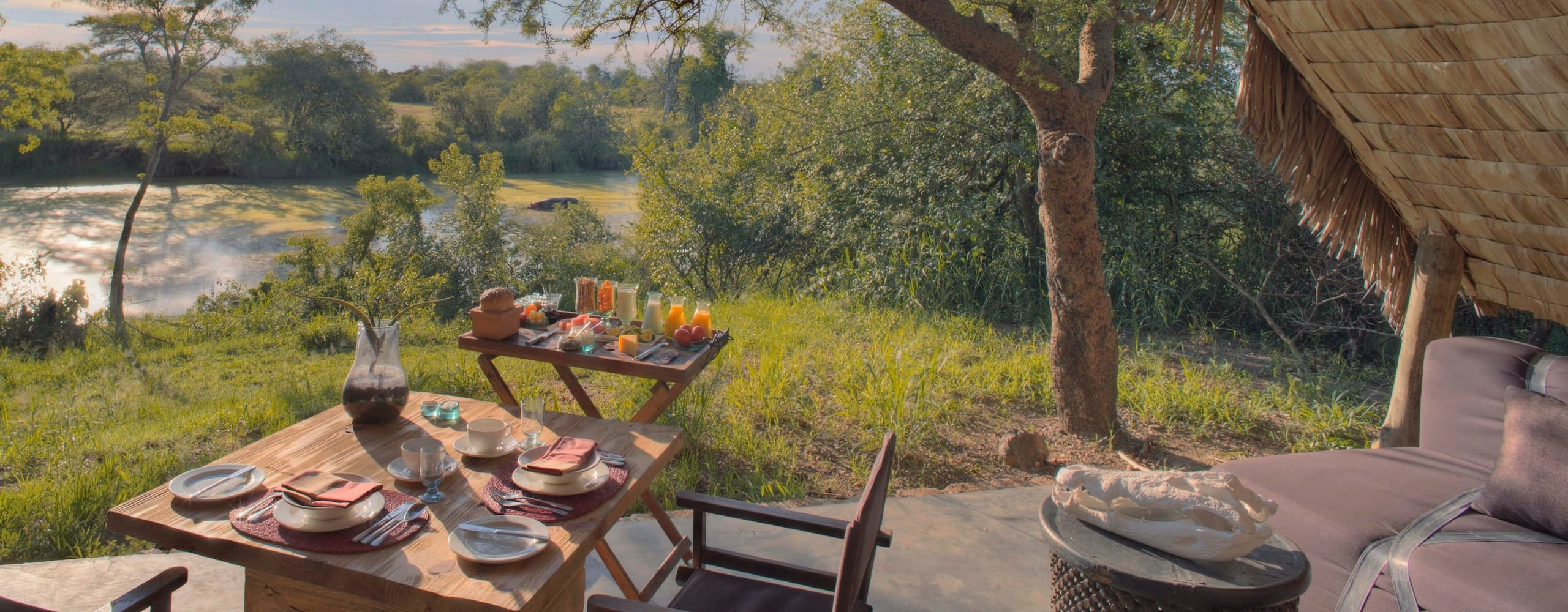 &Beyond Grumeti Serengeti Tented Camp s ideally situated for experiencing the drama of the Grumeti River crossings. © &Beyond