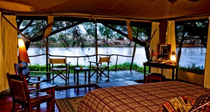 The tents at Wilderness Lodges Larsens Camp have river views. © Wilderness Lodges