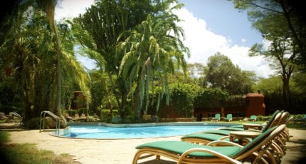 Wind down by the palm-fringed swimming pool at Amboseli Serena Safari Lodge. © Serena Hotels