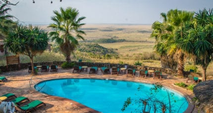 Cool down by the pool at Mara Serena Safari Lodge. © Serena Hotels