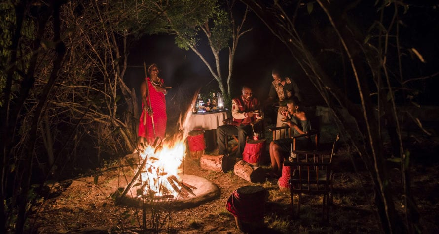 End your day by the campfire at Mara Serena Safari Lodge. © Serena Hotels