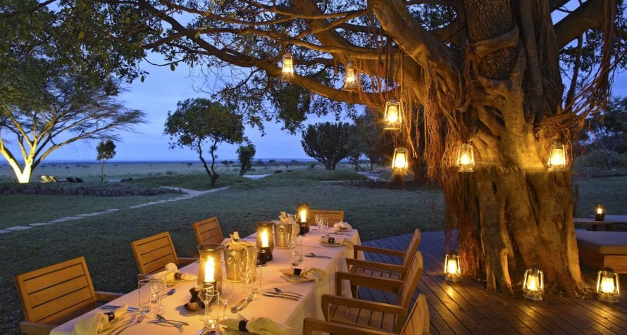 Dinner by lantern light at &Beyond Kichwa Tembo Tented Camp is an unforgettable experience. © &Beyond
