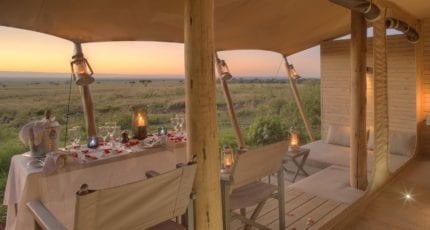 Enjoy a private meal on your verandah at &Beyond Kichwa Tembo Tented Camp. © &Beyond