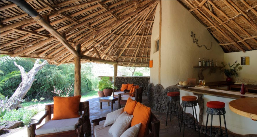 End your day at Elewana Tortilis Camp Amboseli with a refreshing drink in the bar. © Elewana Collection