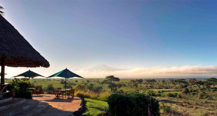 Elewana Tortilis Camp Amboseli overlooks a waterhole. © Elewana Collection