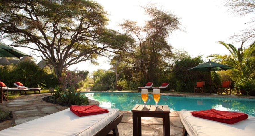 Cool down at the pool at Elewana Tortilis Camp Amboseli. © Elewana Collection