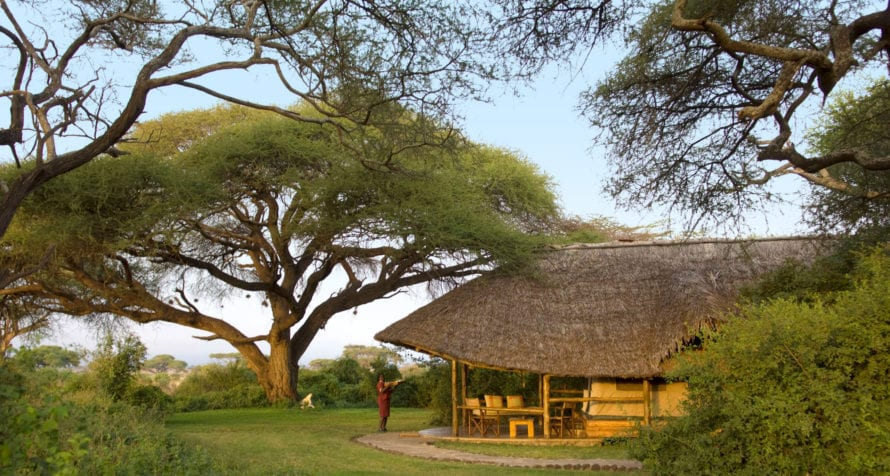 The tented suites at Elewana Tortilis Camp Amboseli are housed under thatch. © Elewana Collection