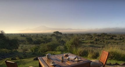 Enjoy tea with a view of Kilimanjaro at Elewana Tortilis Camp Amboseli. © Elewana Collection