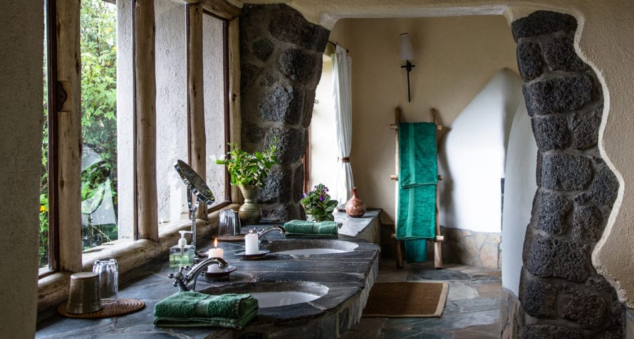 The guest bandas at Volcanoes Virunga Lodge are constructed from stone, with tile roofs. © Volcanoes Safaris