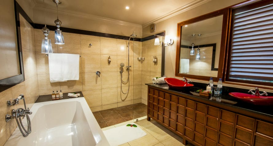 Unwind with a soak in the tub at Elewana Arusha Coffee Lodge. © Elewana Collection