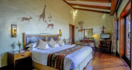 African artwork adorns the guest-suite walls at Ngorongoro Serena Lodge. © Serena Hotels