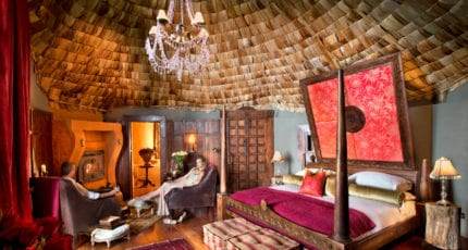 Enjoy a quiet drink in your room at &Beyond Ngorongoro Crater Lodge. © &Beyond