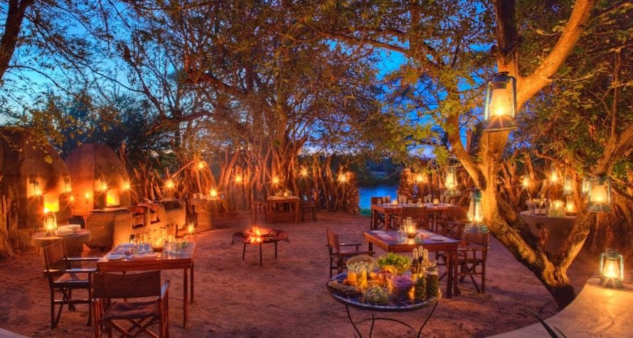 Dinner in the boma at &Beyond Grumeti Serengeti Tented Camp is a memorable affair. © &Beyond