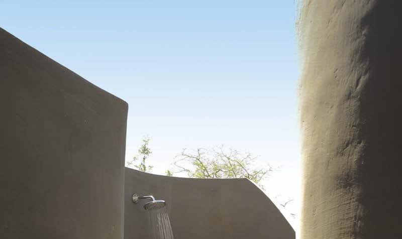 Enjoy an outdoor shower at &Beyond Grumeti Serengeti Tented Camp. © &Beyond