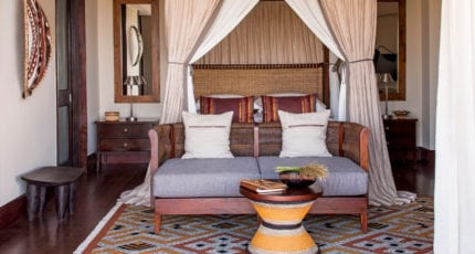The rooms at Four Seasons Safari Lodge have four-poster beds. © Four Seasons